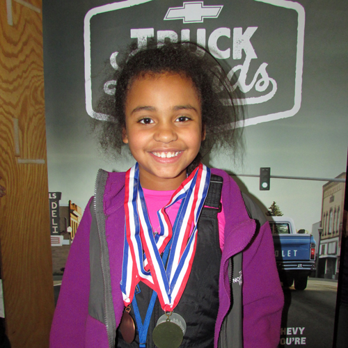girl with medals