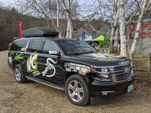 Chevy SUV with sponsors logos